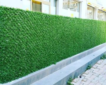 Искусственные заборы из хвои и травы